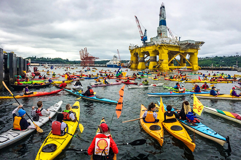 Hundreds of 'kayaktivists' swarm Shell Oil's drilling rig Polar Pioneer, as it arrives in Elliot Bay at the Port of Seattle on May 15, 2015.