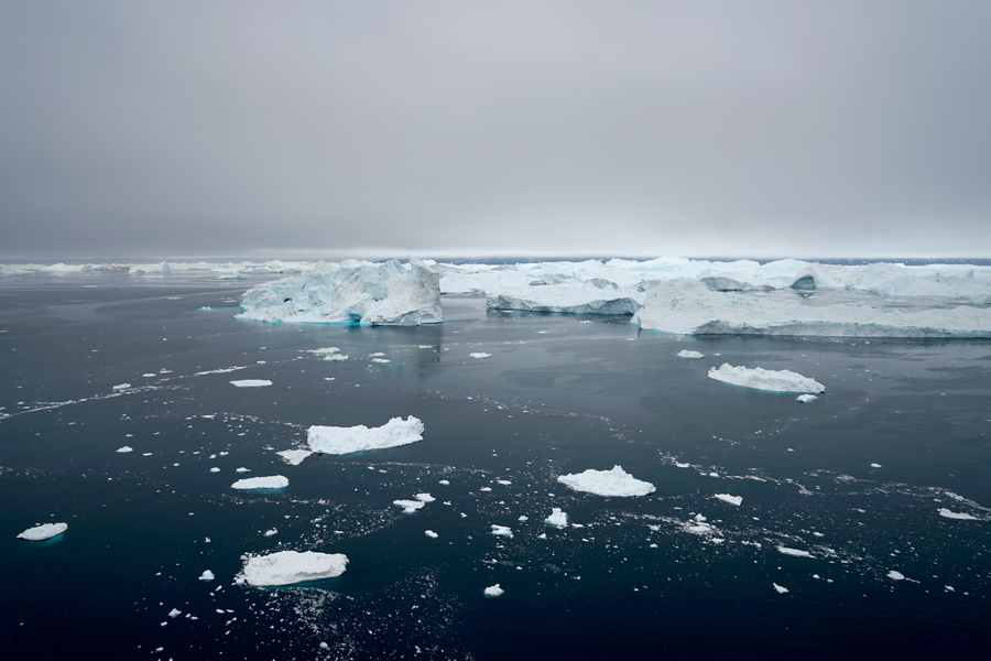Icebergs float on the Arctic Ocean. Extracting and burning oil and gas reserves from the U.S. portion of the Arctic has the potential to release as much as 15.8 billion tons  of carbon dioxide into the global atmosphere.