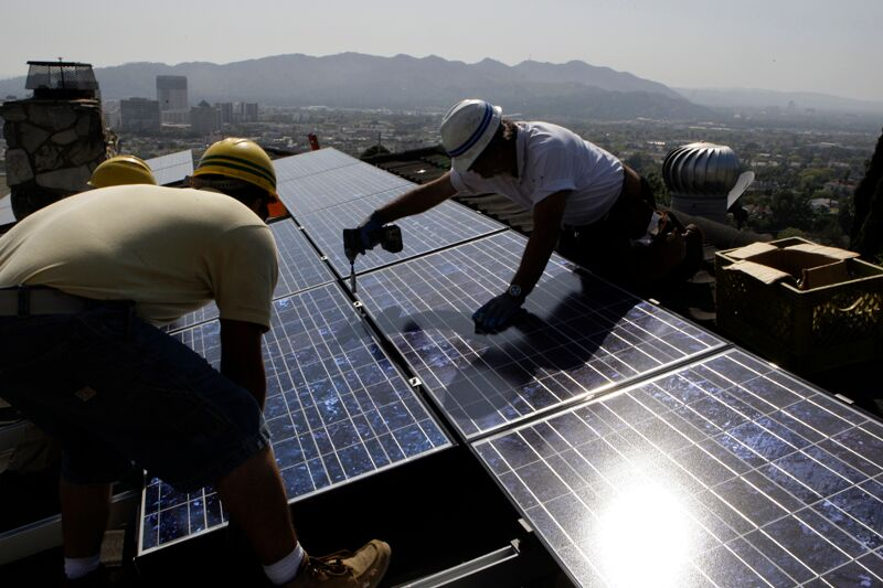Employees of California Green Design installed solar electrical panels on the roof of a home in Glendale, Calif., in 2010.