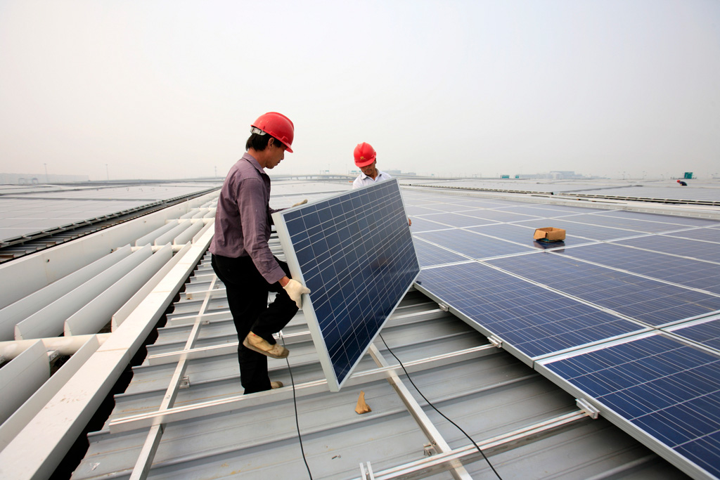 The installation of solar photovoltaic panels on the roofs of the Hongqiao Passenger Rail Terminal in Shanghai, China.