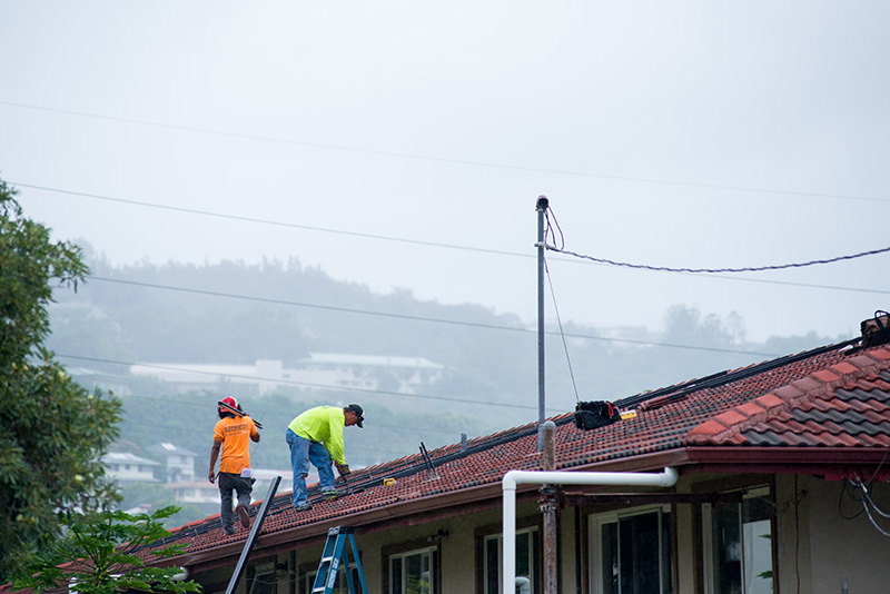 Technicians install solar panels in Honolulu, Hawaii.