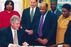 President Clinton signs Executive Order 12898 in 1994. (EPA Photo)