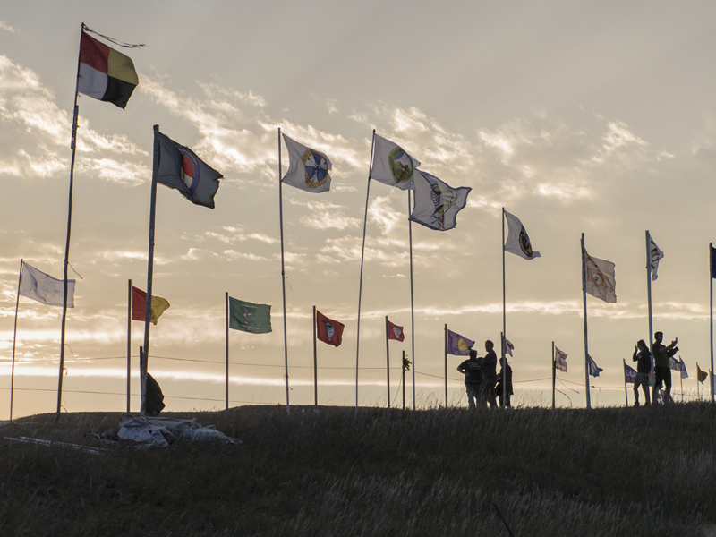 Flags fly at the Sacred Stone Camp in Cannonball, North Dakota.