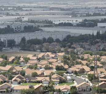 This photo from 2015 shows a vast industrial area that includes numerous logistics facilities near homes in the Rancho Cucamonga and Fontana area of California.