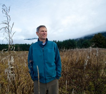 Tom Waldo, one of the legal architects of Earthjustice's Roadless Rule strategy, walks through a field of fireweed near Juneau, Alaska.