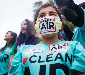 "Janet Rodriguez, a fifth grader from Oakland, Calif., wears a mask adorned with an ""I Love Clean Air"" logo at a rally outside of the EPA Ozone hearing in Sacramento on Feb. 2, 2015."