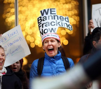 Leslie Roeder, an advocate with New Yorkers Against Fracking, celebrates in front of Govenor Cuomo's office in Manhattan after he announced Wednesday that he would ban hydraulic fracking.