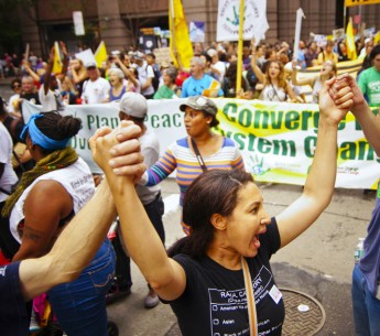 Members of Global Climate Convergence march in the 2014 Peoples Climate March. Saturday's Peoples Climate March in Washington, D.C., will be an expression of solidarity, determination and hope for the future.