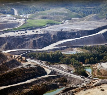 Mountaintop removal mining devastates the landscape, turning areas that should be lush with forests and wildlife into barren moonscapes.