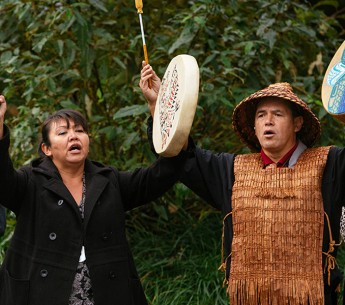 First Nations Swinomish members participate in a traditional ceremony before oral testimonies on the Kinder Morgan TransMountain Pipeline begin.