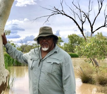 Wangan and Jagalingou cultural leader Adrian Burragubba visits Doongmabulla Springs, his people's most sacred site. The Wangan and Jagalingou are fighting a proposed coal mine that would likely destroy the springs.