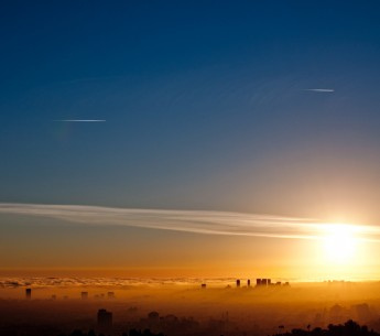 Los Angeles smog and the coastal marine layer meet at sunset.