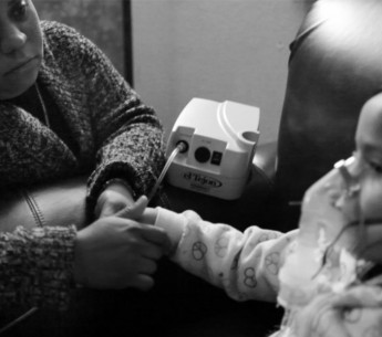 A mother watches over her child during treatment for asthma. It remains to be unsafe to breathe in many parts of the South Coast Air Basin.