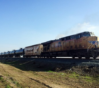 A train transports oil across California's Central Valley, headed towards the Bakersfield Crude Terminal in Kern County.