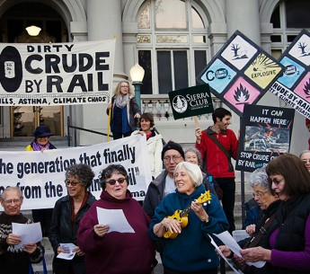 Residents rally outside Berkeley City Hall to show opposition to a proposed crude by rail project.