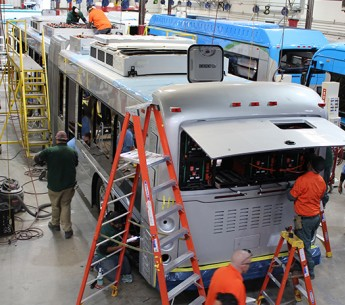 Workers assemble an electric bus at BYD's California facility.
