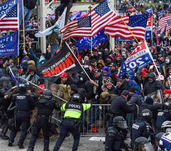 Trump supporters clash with police and security forces as they storm the US Capitol in Washington, DC on January 6, 2021. Demonstrators breeched security and entered the Capitol as Congress debated the a 2020 presidential election Electoral Vote Certifica