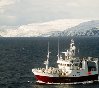 A fishing boat on the Barents Sea off the coast of Norway.