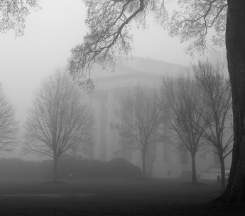 The North Portico of the White House is seen through the fog, April 1, 2013.
