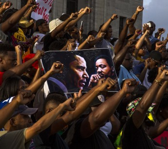 Demonstrators gather after marching at the Louisiana Capitol to protest the shooting of Alton Sterling on July 9, 2016 in Baton Rouge, Louisiana.