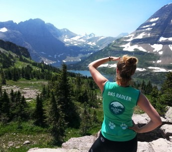 Earthjustice's Jessica Knoblauch looks across a valley toward declining snowpacks in Montana's Glacier National Park.