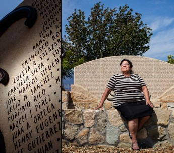 Graciela Silva worked for nine years in the fields harvesting lemons, lettuce, cucumbers, and strawberries. She sits in front of a monument, that includes her name, honoring local farmworkers in Santa Paula, CA.