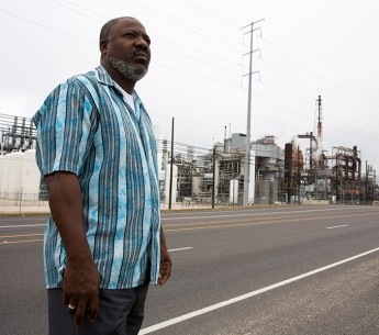 Hilton Kelley stands in front of the Valero oil refinery in Port Arthur, TX, in late November 2013.