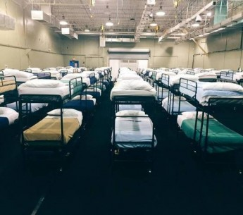 Photo of hundreds of bunk beds in the dormitory at Homestead Detention Center, Biscayne, Florida.