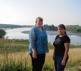 Pennsylvania residents Sabrina Mislevy and Barbara Reed stand near the Little Blue Run coal ash dump site.
