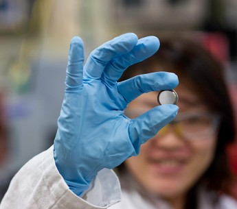 A scientist holds a lithium Ion battery made in the materials lab at the Solar Energy Research Facility at the National Renewable Energy Laboratory in Golden, CO.