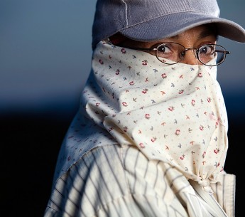 Maria Aguilera, a farmworker for 24 years, has learned to protect herself from toxic chemicals applied to the fields.