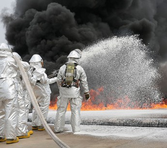 Marines use firefighting foam during a live fire training exercise aboard Marine Corps Air Station Cherry Point in North Carolina in August 2013. PFAS chemicals in firefighting foam have contaminated hundreds of military bases across the country.