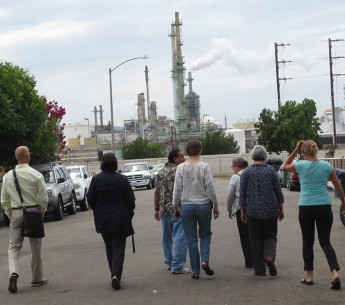 Jesse Marquez of the Coalition for a Safe Environment (third from left) shows EPA staffers and others a Wilmington oil refinery, shortly before the public hearing.