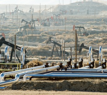 pumpjacks extract oil from an oilfield in Kern County, Calif.