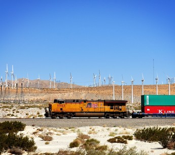 A cargo train passes the windmills outside of Palm Springs, Calif.
