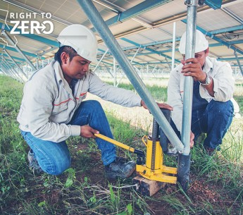 Two engineers check and maintain equipment at a solar power plant. New research shows that many clean energy jobs are a boon for workers from underrepresented communities.