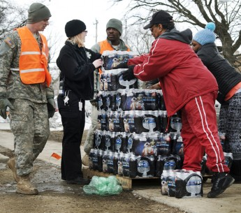 Residents of Flint at a bottled water distribution location in downtown Flint, Michigan on January 23, 2016.