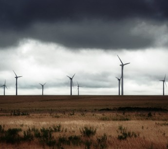 A storm rolls over a Texas wind farm.