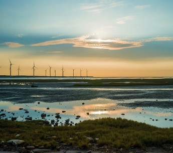 Wind turbines at sunset Jui-Chi Chan/iStock