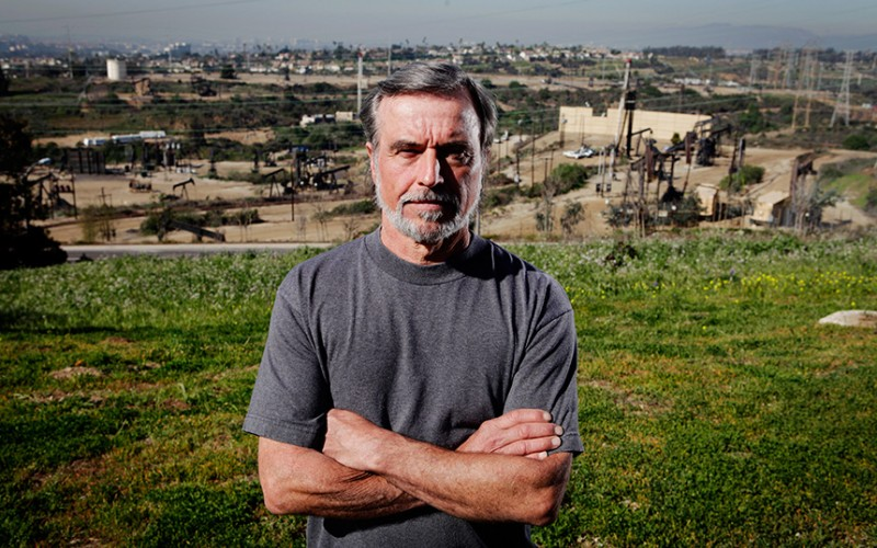 Gary Gless stands in his Windsor Hills neighborhood overlooking the Inglewood Oil Field
