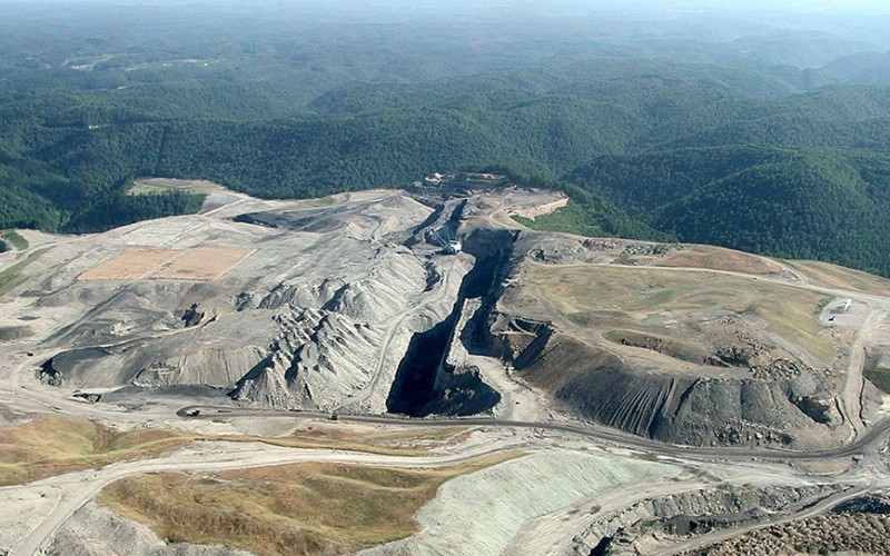 The massive dragline in the photo, which can weigh up to 12 million pounds and be as big as an entire city block, is dwarfed by the scale of this devastation.