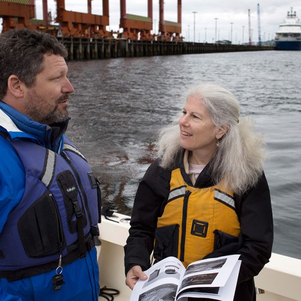 Managing Attorney Patti Goldman speaks with Earthjustice client and Puget Soundkeeper Chris Wilke at Puget Sound on April 28, 2015. The icebreaker ship Aiviq (background) is part of Shell's Arctic drilling fleet.