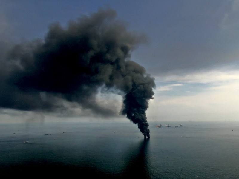 Smoke billows from controlled oil burns near the site of the BP Deepwater Horizon oil spill in June 2010.