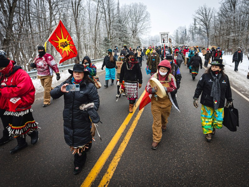Native women lead hundreds of marchers to a spot near where the Line 3 pipeline will cross under the Mississippi River during a protest on Jan. 9, 2021.
