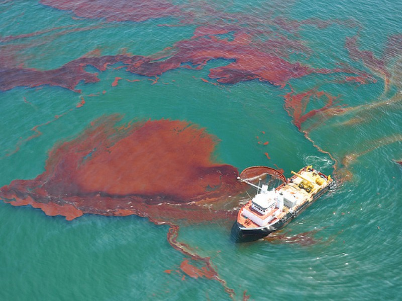 """A """"vessel of opportunity"""" skims oil spilled after the Deepwater Horizon well blowout in the Gulf of Mexico in April 2010. A measure on Florida's ballot this fall could help to prevent future spills."""