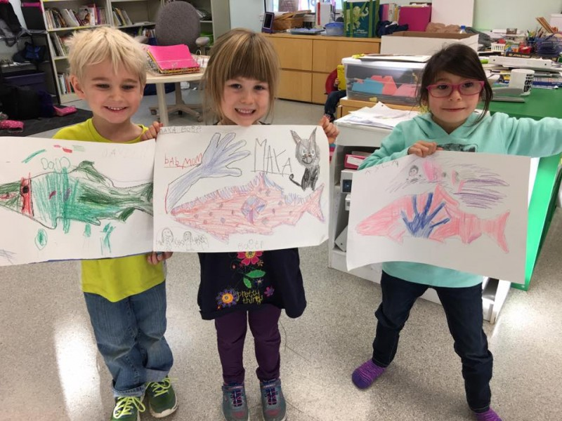 Students at Ya Ne Dah Ah School, the only school in Alaska owned and operated by an Alaska Native tribe, display drawings of salmon. Members of the Chickaloon Native Village worry about the school's fate if the Usibelli Mining Company moves forward with a