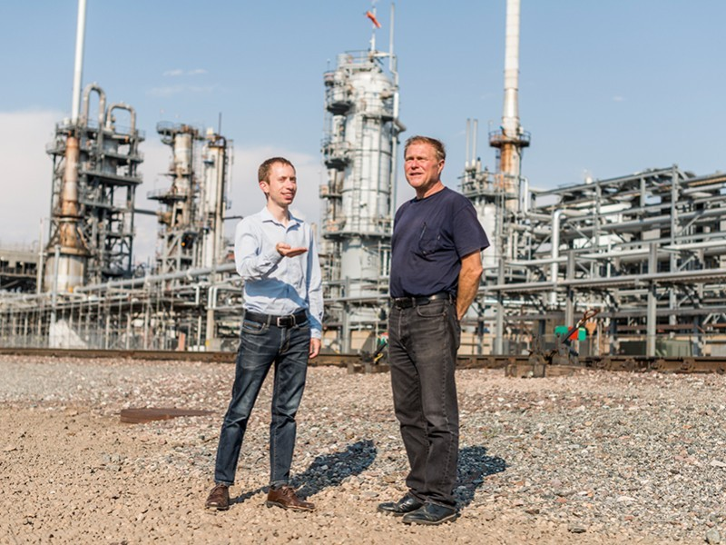 Earthjustice attorney Joel Minor, left, speaks with Drew Dutcher, a Denver resident who must share his community with the Suncor refinery.