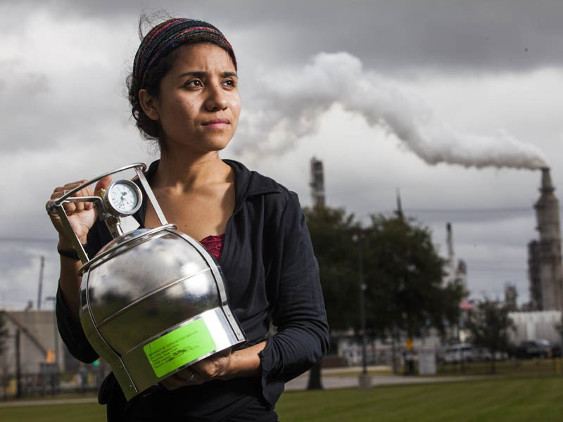 Activist Yudith Nieto holds an air sampler in Hartman Park, in the Manchester neighborhood of Houston, Texas.