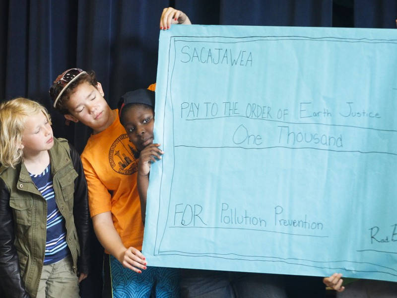 Sacajawea Elementary Students Present a $1,000 check to Earthjustice