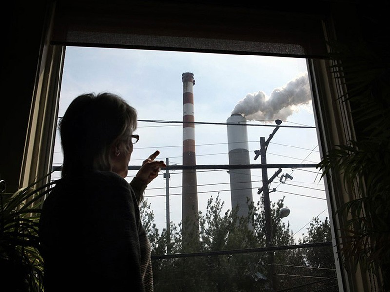 Marti Blake watches the Cheswick Generating Station from her home in Springdale, PA.